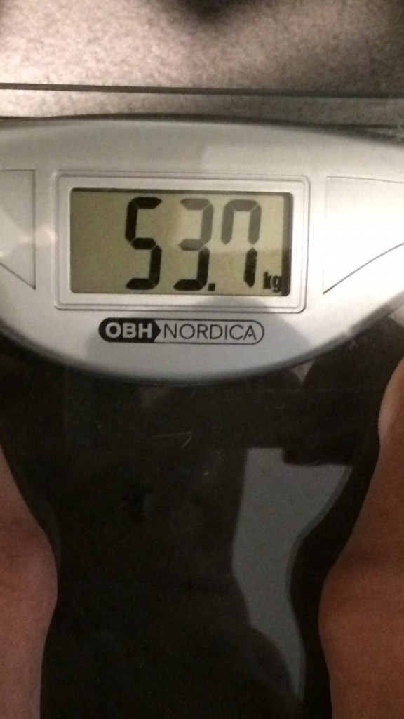 53,7 kg